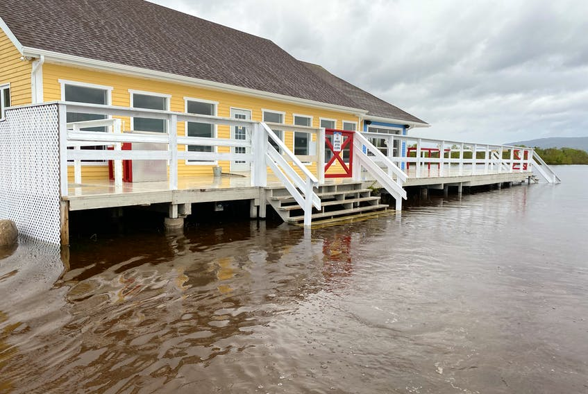 While the rising water from the Humber River has flooded the parking lot at Pasadena Beach, it hasn't reached the deck or floor level of the Oasis Grillhouse located right on the beach. Contributed