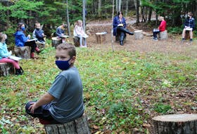 Eight-year-old Kayden Duchene from Louisbourg and the rest of his Riverside School classmates complete an afternoon lesson in the Sharing Circle, one of the outdoor learning spaces along the Knowledge Path at the Albert Bridge school. NICOLE SULLIVAN • CAPE BRETON POST