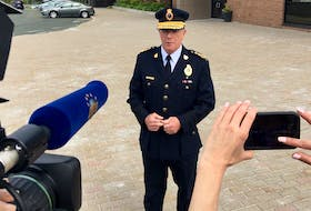 RNC Chief Joe Boland speaks to reporters outside RNC headquarters in St. John's. TELEGRAM FILE PHOTO