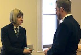 Lawyers Wendy Zdebiak and Jerome Kennedy chat in Newfoundland and Labrador Supreme Court in St. John's Thursday. TARA BRADBURY/THE TELEGRAM