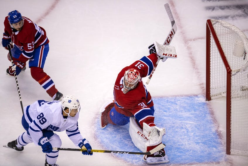 Maple Leafs rookie winger Nicholas Robertson just misses with a backhand against Montreal Canadiens goaltender Carey Price during exhibition play on Tuesday night at Scotiabank Arena.