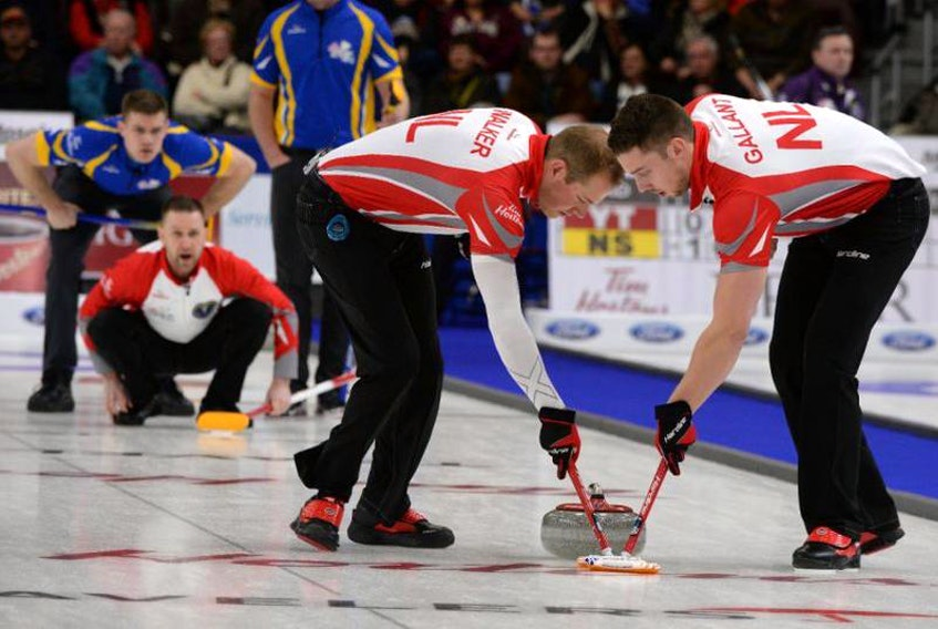 Geoff Walker (centre) is itching to get back to competitive curling after spending the last couple of months practising. COVID-19 restrictions prevented him from playing a couple of bonspiels with Brad Gushue's team last month in Halifax. — Michael Burns/Curling Canada file photo