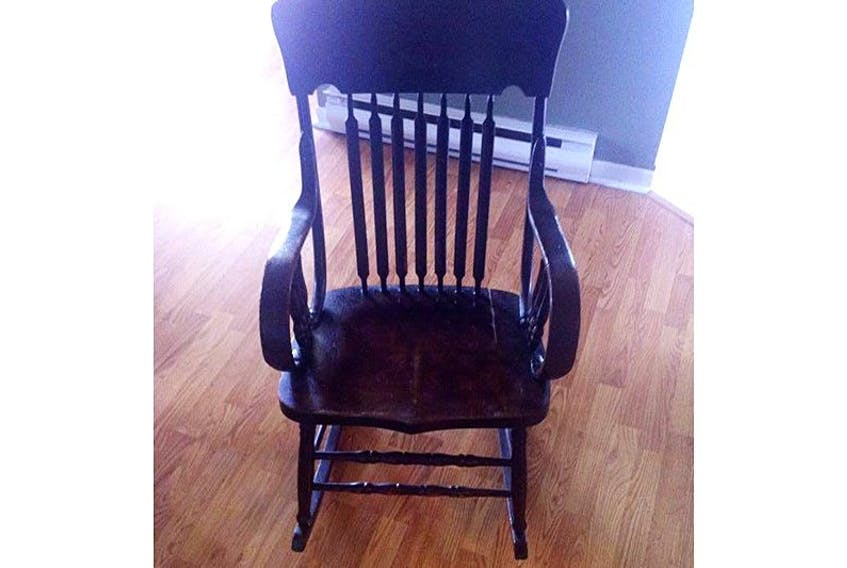 This wooden rocking chair had been in Shelly Butt-Ivey's family for more than 100 years before being sold by accident last week. She's devastated, and is hoping the person who has it will contact her and let her buy it back, with a reward. — Submitted photo