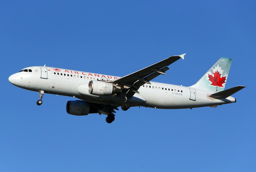 Air Canada said Wednesday it will cut first-quarter capacity by an additional 25 per cent, resulting in a workforce reduction of about 1,700 employees, as travel restrictions, lockdowns and new testing requirements to combat the spread of COVID-19 hit bookings. REUTERS/Ben Nelms/File Photo