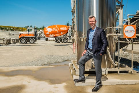 Rob Niven with CarbonCure System and Truck