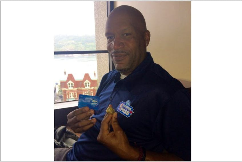Ron Harper may be a retired basketball player, but he has some business sense. Posing for this photo, Harper ensured to include an Air Miles card, along with one of his championship rings from his days with the Los Angeles Lakers. Harper was in St. John's Saturday for the annual NBA Campus Pass event at Memorial University, presented by Air Miles.
