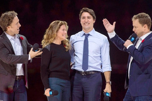 Co-founders Craig, left, and Marc Kielburger introduce Prime Minister Justin Trudeau and his wife Sophie Gregoire-Trudeau at a WE Charity event in Ottawa in 2015. POSTMEDIA