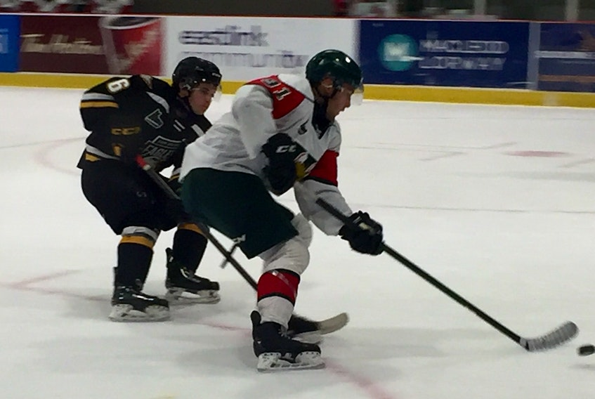 Halifax Mooseheads forward Elliot Desnoyers gets a shot off as Cape Breton Eagles defenceman Matthew Power pursues during Thursday's QMJHL pre-season game against the Cape Breton Eagles at the RBC Centre in Dartmouth. (WILLY PALOV/Chronicle Herald)