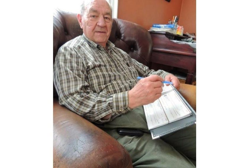 <p>Roy Smith still keeps the books for his church, but says Merigomish is not the bustling community it once was. (Rosalie MacEachern photo) &nbsp;</p>