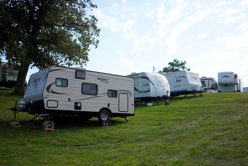 Kingsville's Ken Dunn, a registered respiratory therapist at Erie Shores HealthCare in Leamington, is shown Monday outside the RV parked in his driveway where he's living in order to isolate from his wife and two children during the COVID-19 pandemic.
