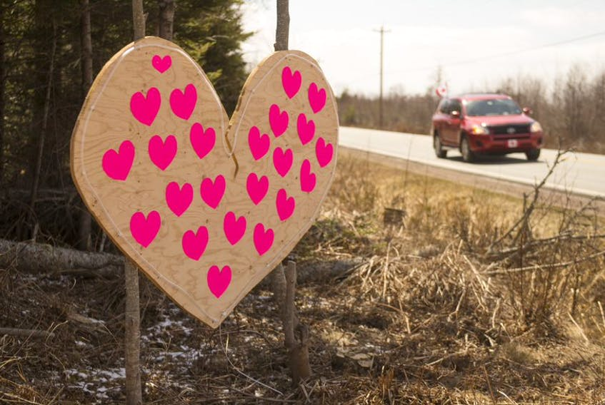 A car passes by a wooden heart along Highway 2 near Highland Village on Thursday, April 23, 2020. The heart was created to remember the victims of the weekend's mass shooting.  Ryan Taplin - The Chronicle Herald