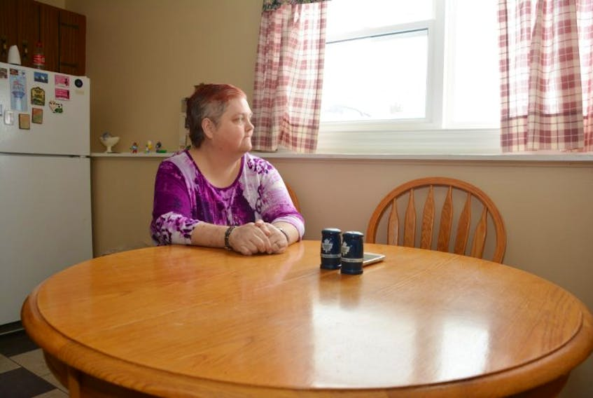 <p>Sandra Gallant, of Summerside, sits are her kitchen table. Gallant is currently preparing legal action against the Canadian National Institute for the Blind and she's not the only one in Summerside and Atlantic Canada doing so. Colin MacLean/Journal Pioneer</p>