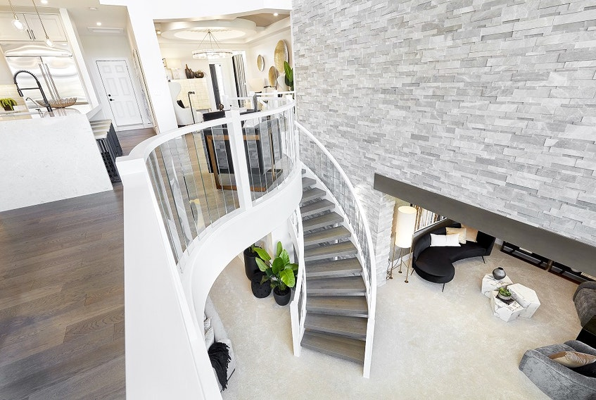The curving staircase from the main level to the walkout basement in the Sapphire show home by Jayman Built in Edgewater Estates. Courtesy, Jayman Built