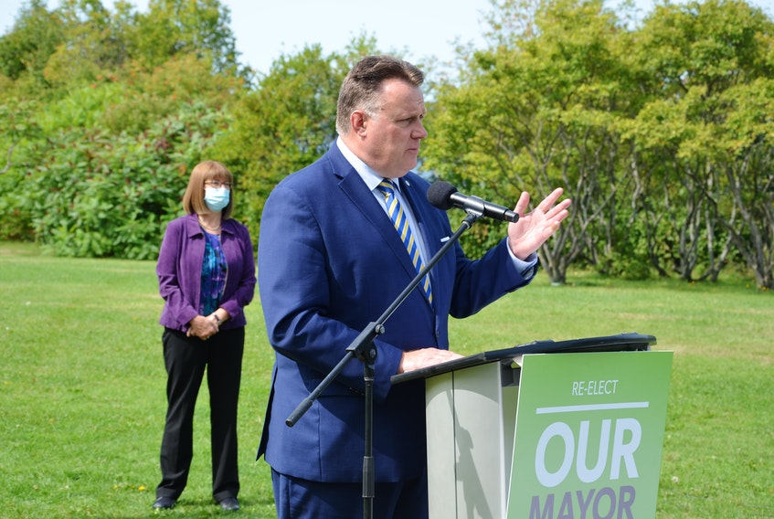 Mike Savage, with former Liberal cabinet minister Diana Whalen backing him up, kicks off his campaign for a third term as mayor of Halifax Regional Municipality at Africville Park on Tuesday, Sept. 15.