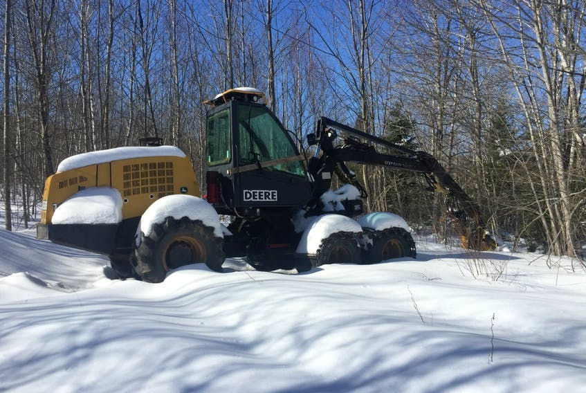 A harvester sits idle in Antigonish County on Saturday. (AARON BESWICK PHOTO)
