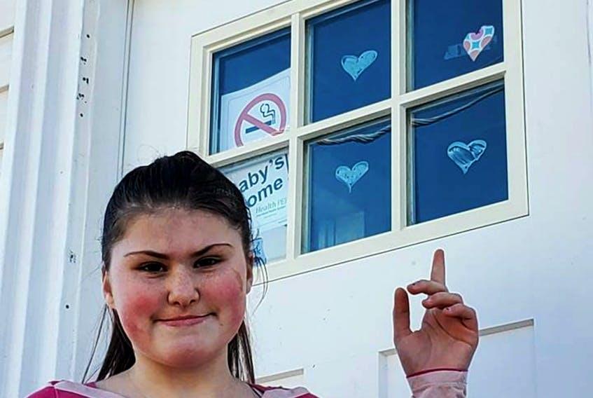 Alina Richards goes on a heart hunt around Summerside on Sunday afternoon.