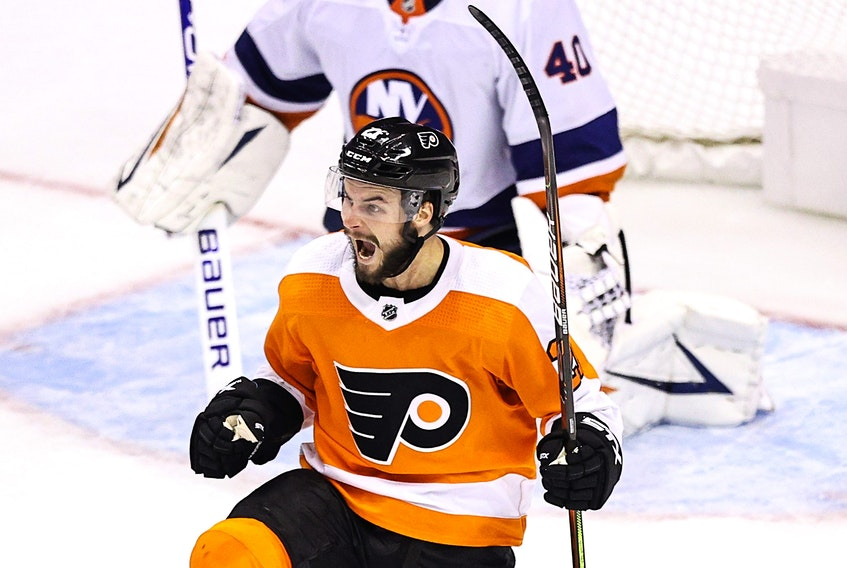 Philadelphia Flyers' Scott Laughton celebrates after scoring the game-winning goal against the New York Islanders during the first overtime period to win Game 5 against the New York Islanders on Tuesday night in Toronto.