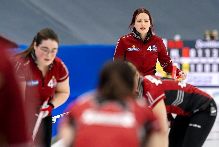 After watching her team win its first two games at the 2021 Scotties Tournament of Hearts, rookie skip Sarah Hill (background) found it difficult to add to the victory total. — Andrew Klaver/Curling Canada