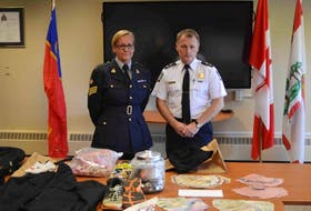 RCMP Sgt. Leann Butler and Charlottetown Police Services Deputy Chief Brad MacConnell stand behind some of the items a joint task force recovered from the thief that has become known as the screencutter. Richard Joseph Arsenault, who entered a not-guilty plea in early November in this case, goes to trial Tuesday in Charlottetown.