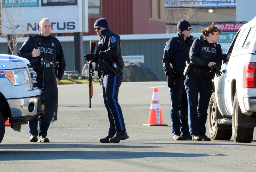 Members of the Royal Newfoundland Constabulary surrounded the house at 374 Empire Avenue Monday after receiving information that an assault suspect was there. Keith Gosse/The Telegram