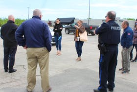 Heather Peters, facing the group on the left, talks with representatives from Cape Breton Regional Police, the Grand Lake Road Volunteer Fire Department and other Riverview High School parents in the parking lot of the Mayflower Mall on Friday. Beside Heather facing the group is her daughter Madison MacInnis who is in her graduating year. The group was discussing plans for the school's upcoming drive-in grand march celebration taking place on June 21, which was confirmed the evening before their meeting. NICOLE SULLIVAN/CAPE BRETON POST