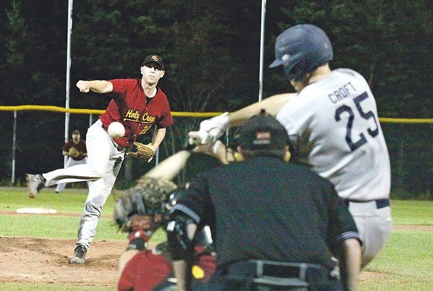 The Holy Cross Crusaders' Sean Janes delivers a pitch to the Gonzaga Vikings' Troy Croft in Game 7 of the St. John's senior baseball league final Monday night atSt. Pat's BallPark.The Vikings won 4-0 to complete a comeback from a 3-1 series deficit and claim their first title since 2008.