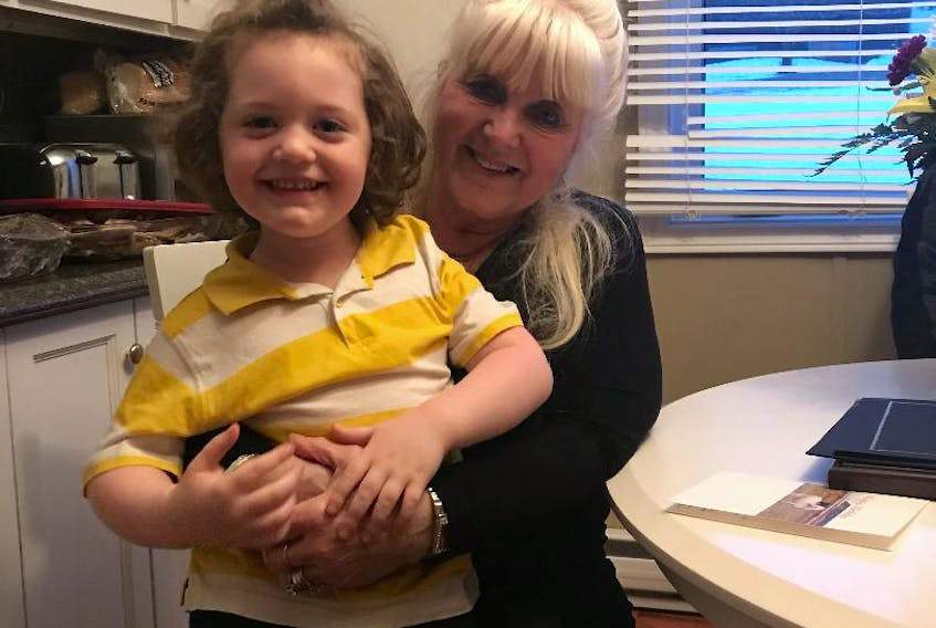 Betty Fitzgerald enjoyed a visit from her neighbour, four-year-old Owen Sheppard. Contributed