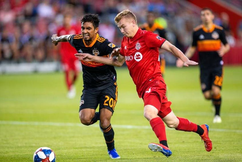 Toronto FC attacker Jacob Shaffelburg, right, battles for the ball against Houston Dynamo defender A. J. DeLaGarza during a July 20, 2019 MLS game at BMO Field. (Kevin Sousa/USA TODAY Sports)
