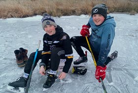 Charlie MacMillan of Little Bras d'Or and right, Carter Petite of Georges River were accompanied by adult family members as they skated on Gammell Lake, near the border of Georges River and North Sydney late last month.  Charlie is the son of John and Angela MacMillan and Carter is the son of Norm and Darlene Petite. Conditions can change daily and those venturing out should check the thickness of all ice surfaces. CONTRIBUTED