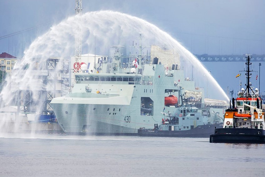 HMCS Harry deWolf heads from the Irving-owned Halifax Shipyard on its way to being delivered to the Royal Canadian Navy dockyard in Halifax on July 31, 2020.