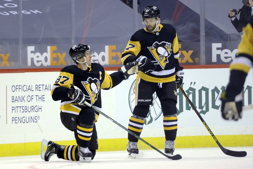 Pittsburgh Penguins'  Sidney Crosby (87) celebrates his goal with  Bryan Rust (17) against the Washington Capitals in the third period of an NHL game on Sunday. Crosby's empty-net goal allowed him to pass Al MacInnis as the highest scoring Nova Scotia  player in NHL history. Charles LeClaire-USA TODAY Sports