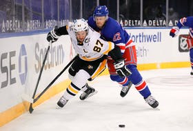 Sidney Crosby of the Pittsburgh Penguins battles Anthony Bitetto of the New York Rangers for the puck during an NHL game at Madison Square Garden on Febr. 01, 2021. (Sarah Stier/POOL PHOTOS-USA TODAY)