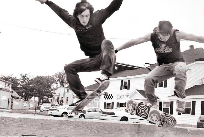 <p>In this file photo, two Digby youngsters practice their skateboard jumps in a downtown parking lot.</p>
