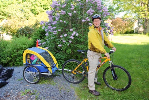 Coun. Sam Austin on his yellow Trek 7000 in happier times (child and trailer still accounted for).