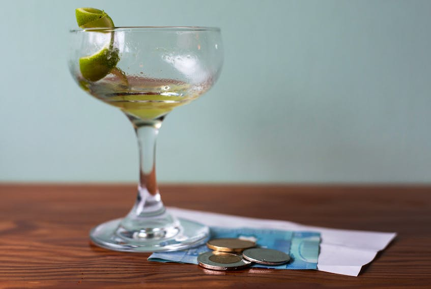 In a photo illustration, a tip is left behind with a finished drink at Field Guide in Halifax, N.S. on Wednesday, March 4, 2020.