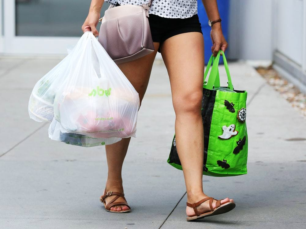 A customer leaves a Sobeys grocery store carrying a plastic bag in Ottawa, Ontario, Canada, July 31, 2019.