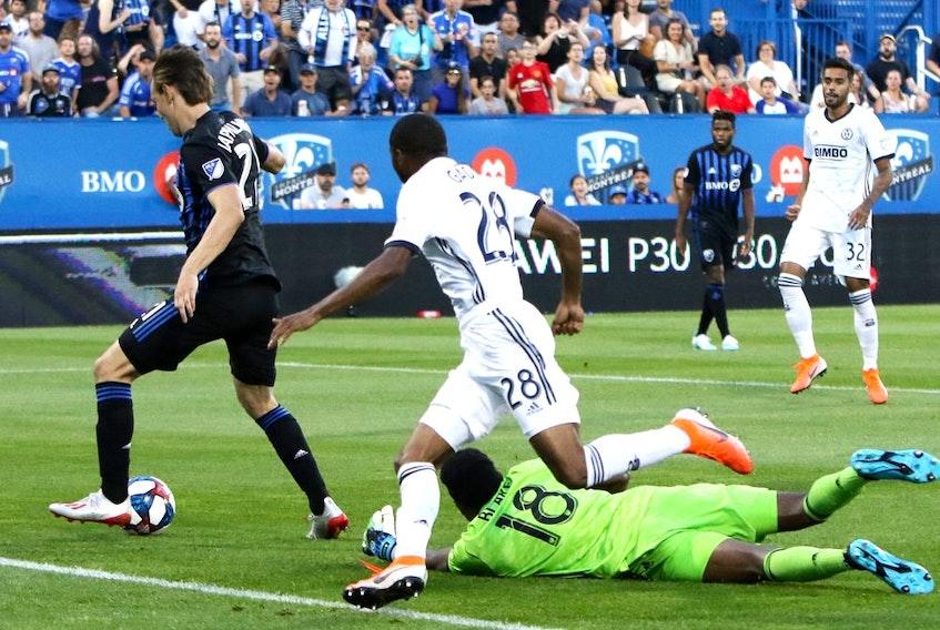 Montreal Impact midfielder Lassi Lappalainen (21) scores past Philadelphia Union goalkeeper Andre Blake (18) during the first half at Saputo Stadium on Saturday, July 27, 2019.