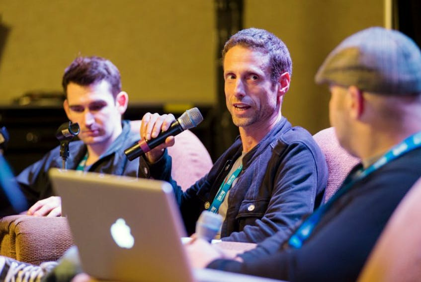 Sound of Pop owner Glenn McMullen, centre, talks sync placements as a panelist at a Music New Brunswick conference.