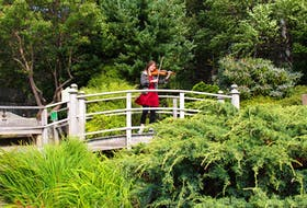 """Carole Bestvater is one of 14 musicians taking part in the Sound Symposium's """"Echo Village"""" at the Memorial University Botanical Garden on Sunday. The performers will be in different areas throughout the garden, performing a variety of different styles. – Andrew Waterman/The Telegram"""