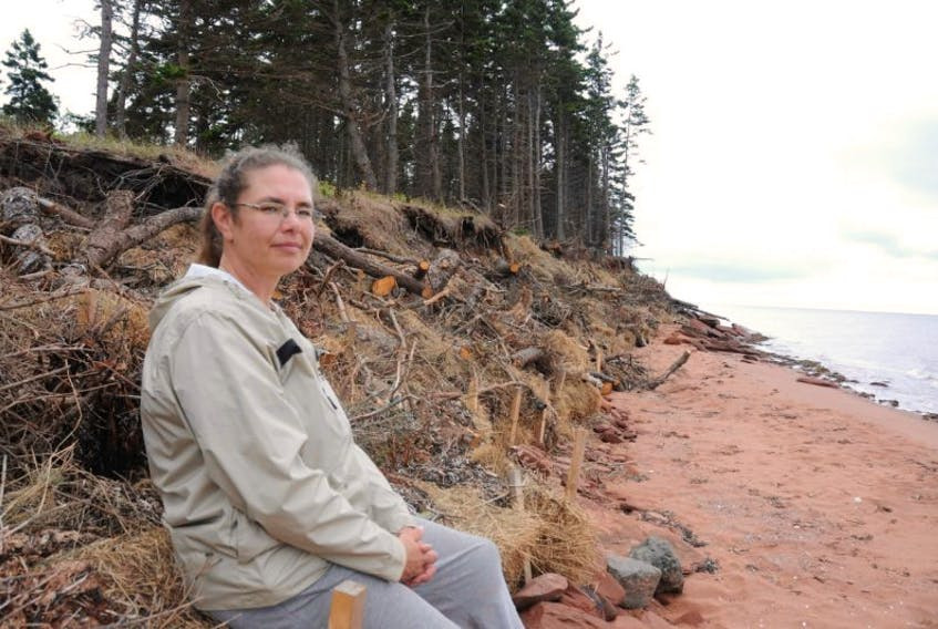 <p>Kellie Lockhart, manager of the South Shore Watershed Association, with the living shoreline her group recently built in Augustine Cove. The method is used as a long-term solution to coastal erosion.&nbsp;</p>