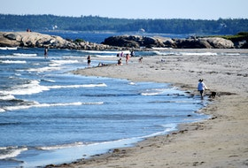 People enjoy a day at the beach at Beach Meadows, Queens County, one of the many white sand beaches along the South Shore.  Kathy  Johnson file photo