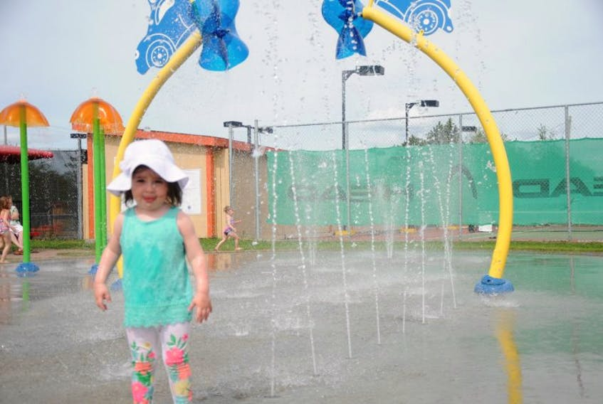 Nearly two-year-old Myla Winsor enjoyed the afternoon running through the streams of water at the Splash Pad in Gander.