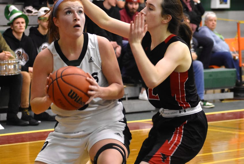 Avery McKinnon of the Breton Education Centre Bears, left, looks at the basketball net as she's watched by Maddie Long of the Northumberland Nighthawks during New Waterford Coal Bowl Classic action at the Breton Education Centre gym earlier this month. Is it time for the girls team to have a tournament, similar to Coal Bowl? JEREMY FRASER/CAPE BRETON POST