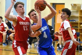 In this file photo, Adam Callaghan of the Sydney Academy Wildcats, middle, works his way to the rim as he's pressured by Millwood Knights players Morgan Rae, left, and Zach Duke during tournament play this past season. Callaghan is now a recruit of Mount Saint Vincent University. JEREMY FRASER/CAPE BRETON POST.