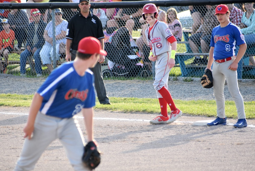 In this file photo, pitcher Ethan Lesieur of the Victoria Capitals watches Matthew MacDonald, middle, of the Cape Breton Ramblers closely as first baseman Seth Feldhuhn prepares for the throw over during Canadian Senior Little League Championship action at the Nicole Meaney Memorial Ball Park in Sydney Mines in July 2019. The 2021 national championship is slated for Sydney Mines in July. JEREMY FRASER/CAPE BRETON POST