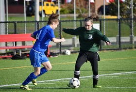 Marley MacGillivary of the Breton Education Centre Bears, right, protects the ball as Ella Greencorn pressures during Cape Breton High School Soccer League girls junior varsity action at Open Hearth Park in Sydney, in this file photo. An announcement on high school soccer has yet to be made, but with recent changes to COVID-19 guidelines, there's still hope for the soccer season. JEREMY FRASER • CAPE BRETON POST