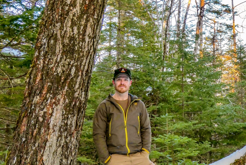 Adam Malcolm, founder of the Facebook group Stop Clearcutting Unama'ki and the Instagram account @ns.speciesatrisk, in the woods near River Inhabitants, Richmond County, on Feb. 24. CONTRIBUTED