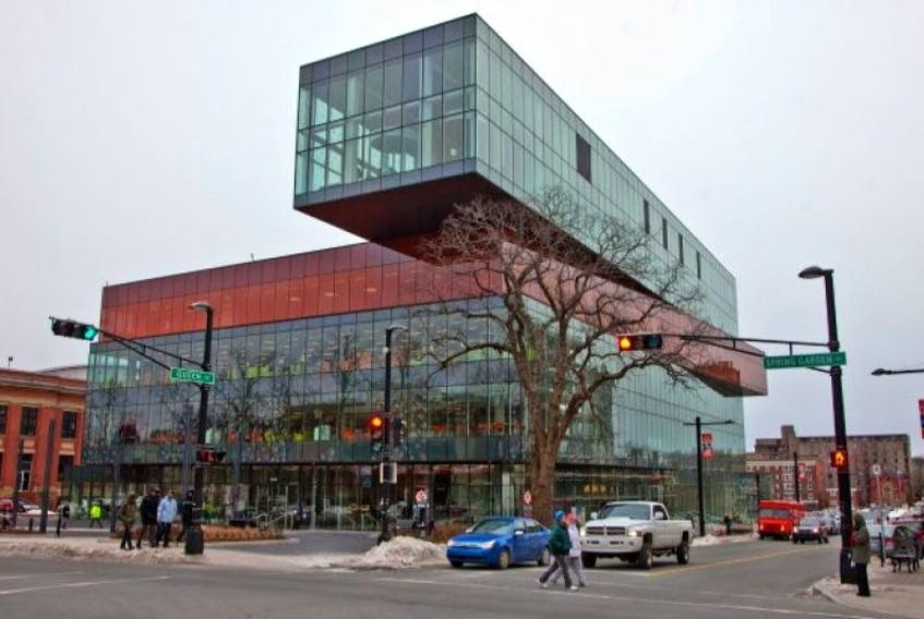 Pedestrians cross Spring Garden Road past the new Halifax Central Library.