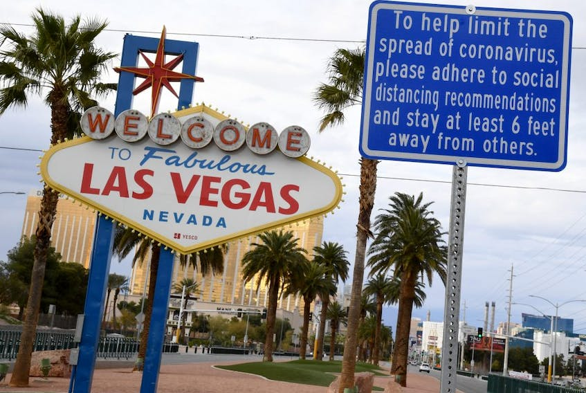 A message on a sign placed in front of the Welcome to Fabulous Las Vegas sign, where tourists often line up to take photos, displays a message about social distancing due to the continuing spread of the coronavirus across the United States on March 22, 2020 in Las Vegas, Nevada. On Friday, Nevada Gov. Steve Sisolak ordered a mandatory shutdown of most nonessential businesses in the state until April 16 to help combat the spread of the virus. The World Health Organization declared the coronavirus (COVID-19) a global pandemic on March 11th.  (ETHAN MILLER/Getty Images)