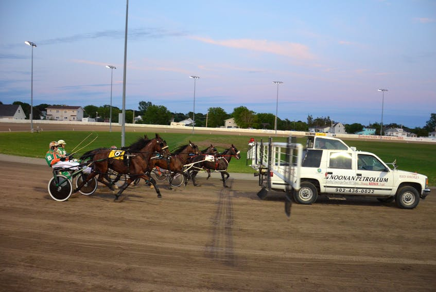 Harness racing action at Red Shores at Summerside Raceway.